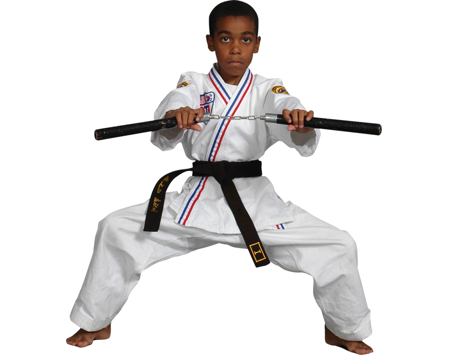Boy using martial arts weapon