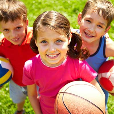 young kids with sports equipment